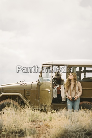 two women by a 4x4 in