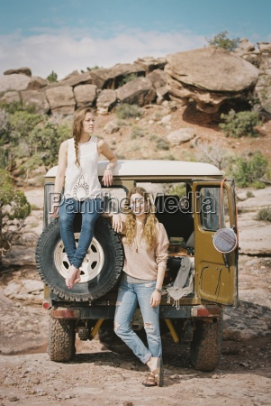 two women standing by a 4x4