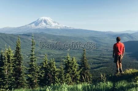 male hiker on a mountain summit