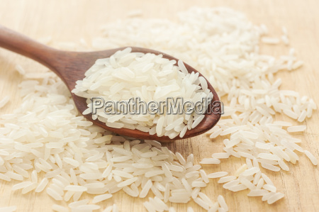 rice white rice in wooden spoon