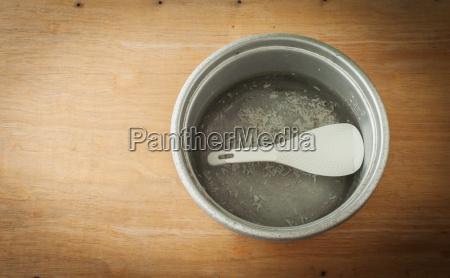 old aluminium pot on a wooden