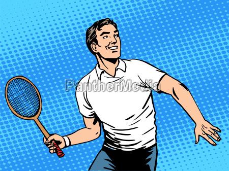 handsome man playing tennis