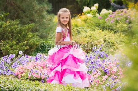 girl princess in the garden flower