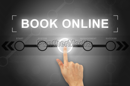 hand clicking book online button on