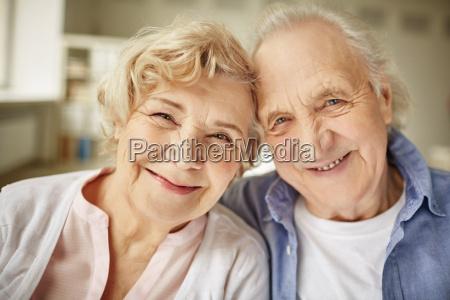 faces of senior couple