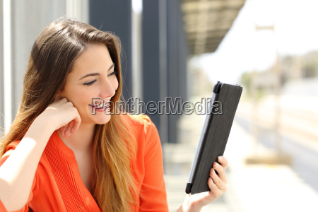 woman reading a tablet or ebook