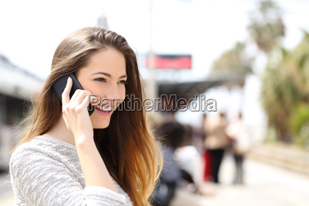 woman talking on the phone waiting