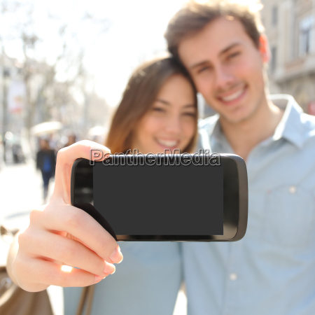 couple making a selfie photo with