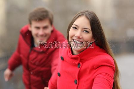 happy couple running towards camera in