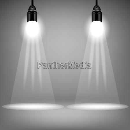 zwei scheinwerfer auf weichem grauem hintergrund