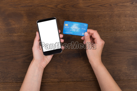 person hands with credit card and