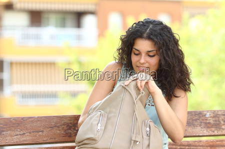 woman searching something in her hand