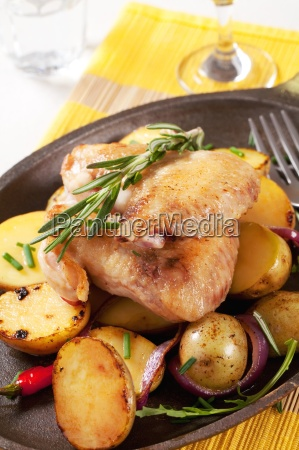 roasted chicken wings and potatoes