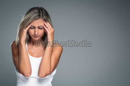 gorgeous young woman with severe headachemigrainedepression