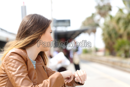 angry girl waiting in a train