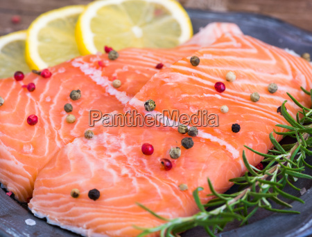 raw salmon fish fillet with lemon