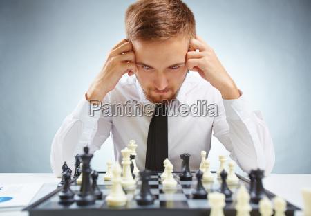 businessman over chessboard