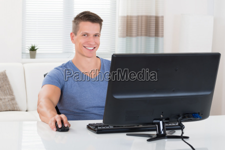 man using desktop computer