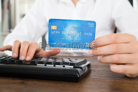 businesswoman with computer keyboard and credit
