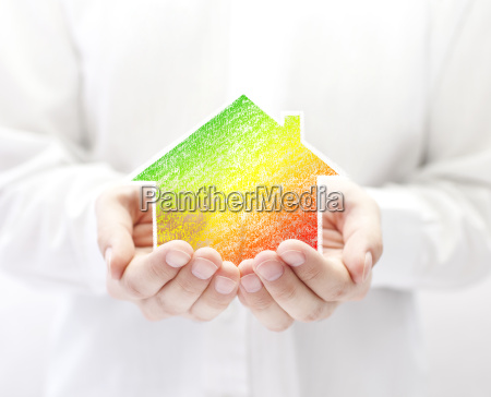 drawing of colorful house in hands
