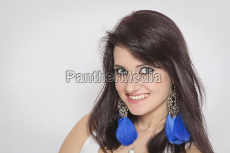 woman portrait with blue feather earrings