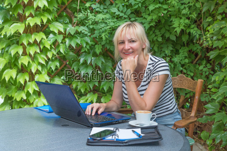 smiling blonde middle aged woman in