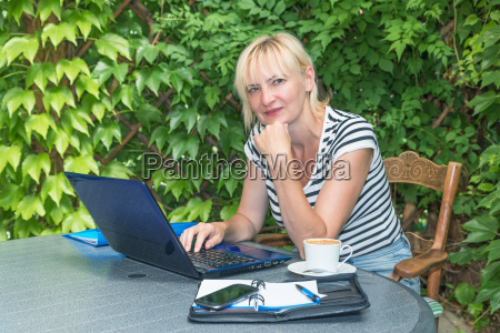 blonde middle aged woman is sitting