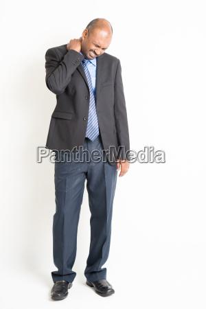 full length mature indian businessman shoulder