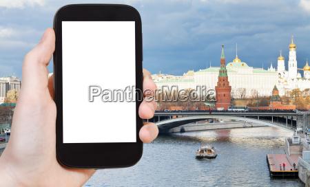 smartphone and bridge near moscow kremlin