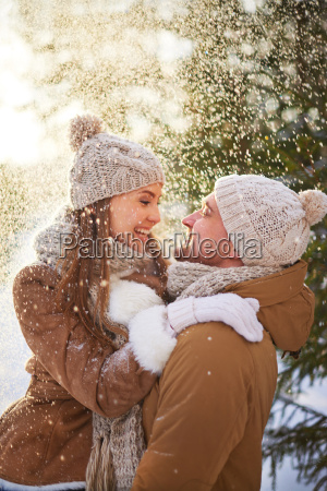 couple under snowfall