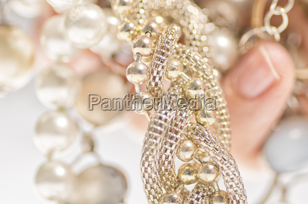 expensive jewelry in womans hand
