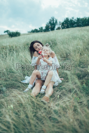 the young mother and daughter on