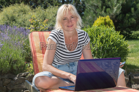 relaxed blonde middle aged woman