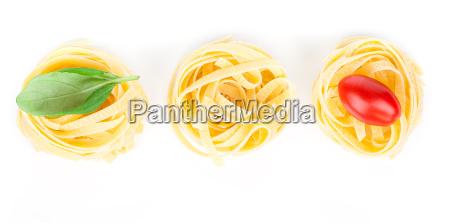 italian pasta fettuccine nest with basil