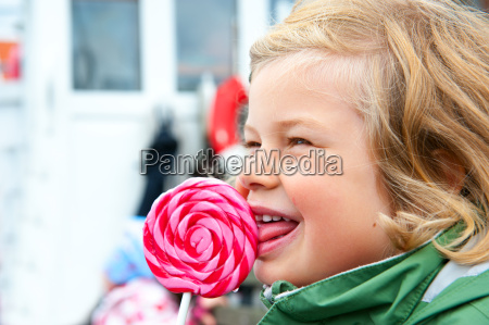 little girl with big round lolipop