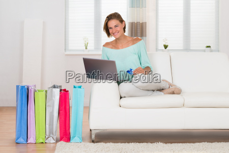 woman shopping online with shopping bags