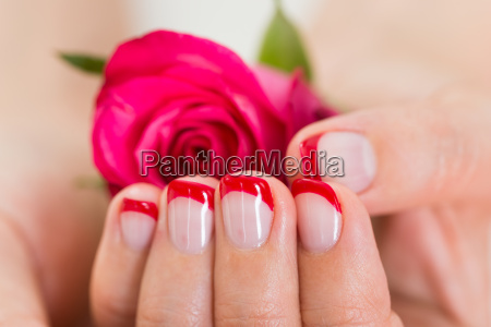 manicured nail with nail varnish holding