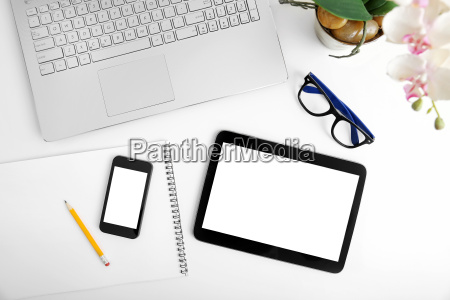 workspace with laptop blank digital tablet