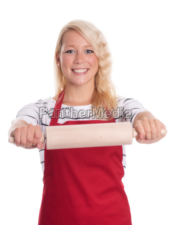 housewife in apron holding a rolling