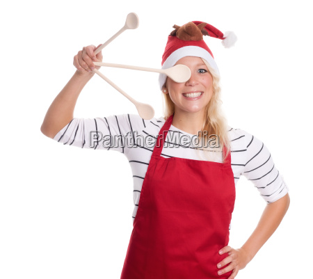 christmas woman holding a wooden spoon