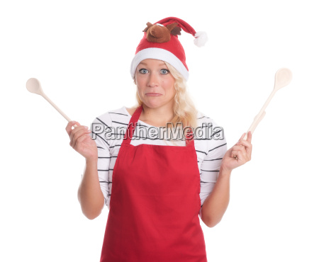 christmas woman with spoons looks skeptical