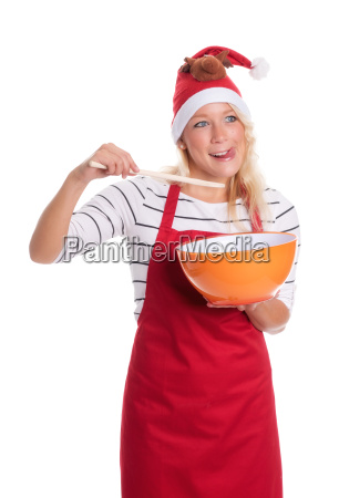 christmas woman in apron with mixing