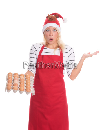 christmas woman with apron holding eggs