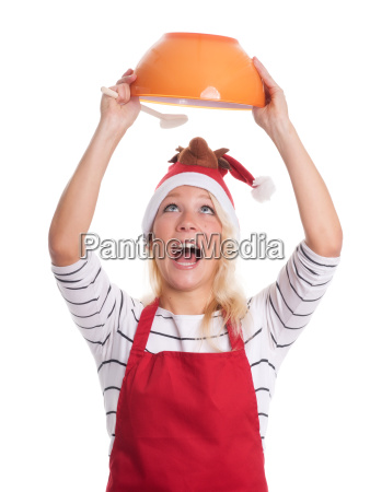 christmas woman with apron looks into