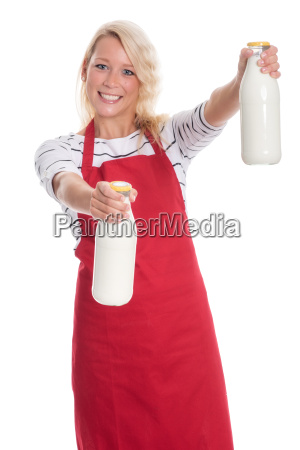 woman in apron holding two liters