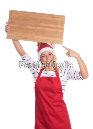 christmas woman in apron pointing at