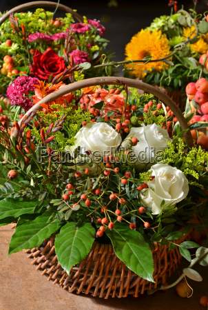 wicker basket filled with autumn flowers