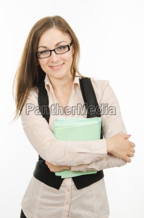 portrait eines gluecklichen lehrer mit notebooks