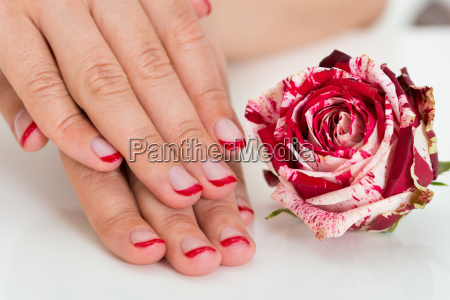 female hands with nail varnish near