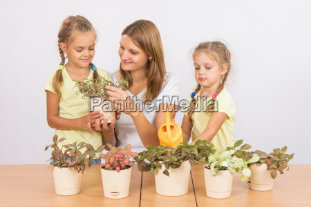 mom and daughter caring for plants